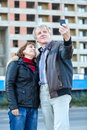Mature couple making selfie standing together caucasian Royalty Free Stock Photography