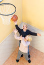 Mature couple playing basketball in patio Royalty Free Stock Photo