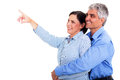 Mature couple pointing beautiful on white background Stock Image
