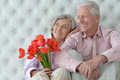 Mature couple with poppies Royalty Free Stock Photo