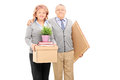 Mature couple posing with moving boxes isolated on white background Royalty Free Stock Photo