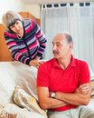Mature couple after quarrel in living room family conflict at home Royalty Free Stock Images