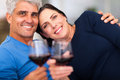 Mature couple relaxing happy holding wine glass and having good time Stock Photos