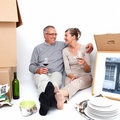 Mature couple relaxing after moving house Royalty Free Stock Photo