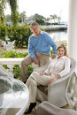 Mature couple relaxing on terrace Royalty Free Stock Photography