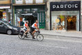 Mature couple ride tandem bicycle porto portugal june in old city on june in porto portugal Royalty Free Stock Image