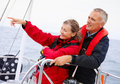 Mature couple on a sea voyage, pointing away Royalty Free Stock Photography