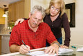 Mature Couple - Signing Paperwork Royalty Free Stock Photo