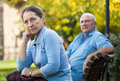 Mature couple sitting on   bench Royalty Free Stock Photo