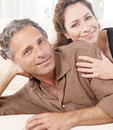 Mature couple on sofa. Stock Photography