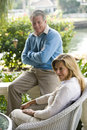 Mature couple on sunny terrace Stock Photos
