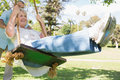 Mature couple at swing in the park low angle view of a Royalty Free Stock Photos