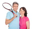 Mature couple with tennis racquets Stock Image
