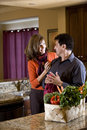 Mature couple together in kitchen at home Royalty Free Stock Photography