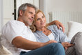 Mature couple vision portrait of happy on sofa looking at the future Stock Image