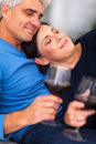 Mature couple wine loving enjoying at home Stock Image