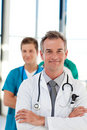 Mature doctor leading his team with copy-space Royalty Free Stock Photo