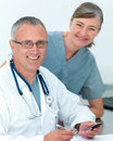 Mature doctor and nurse ready to help you Stock Photos