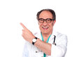 Mature doctor pointing upwards and away Stock Image