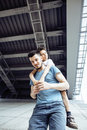 Mature father with his son under the bridge having fun together happy family, lifestyle people concept Royalty Free Stock Photo