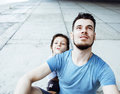 Mature father with his son under the bridge having fun together Royalty Free Stock Photo
