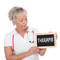Mature female doctor with board Royalty Free Stock Photo