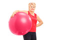 Mature female holding a pilates ball isolated on white background Stock Images