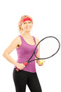 Mature female tennis player holding a racket and a ball isolated against white background Stock Images