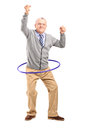 Mature gentleman dancing with a hula hoop full length portrait of isolated on white background Stock Photos