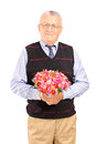 A mature gentleman holding bouquet of flowers Royalty Free Stock Image