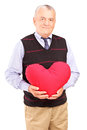 Mature gentleman holding a red heart Stock Photos