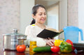 Mature housewife dreams with book Royalty Free Stock Photo
