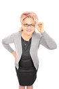 Mature lady with glasses looking at camera isolated on white background Royalty Free Stock Photo