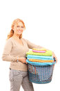 Mature lady holding a laundry basket isolated on white background Stock Image