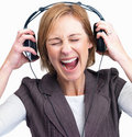Mature lady screaming while listening to loud Royalty Free Stock Photography