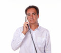 Mature latin man speaking on phone portrait of a white stylish shirt while looking at you isolated studio Stock Images