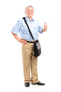 Mature mailman giving a thumb up full length portrait of isolated on white background Stock Image