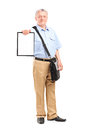 Mature mailman holding a clipboard full length portrait of isolated on white background Stock Image