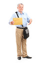 Mature mailman holding an envelope full length portrait of a isolated on white background Royalty Free Stock Images