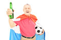 Mature male sport fan with flag of holland holding beer bottle and soccer ball isolated on white background Stock Photo