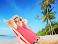 Mature male tourist enjoying on a beach next to a sea tropical and palm trees Stock Photography