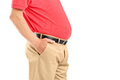 Mature man with belly posing isolated on white background Stock Photo