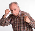Mature man in boxer pose with raised fists ona white background Stock Image