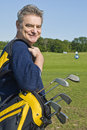 Mature Man Carrying a Golf Bag Royalty Free Stock Image