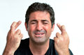 Mature man with crossed fingers hoping for luck Royalty Free Stock Photo