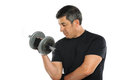 Mature Man Curling Dumbbells Stock Photo