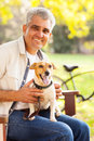 Mature man dog smiling and pet outdoors Royalty Free Stock Photo