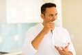 Mature man drinking coffee handsome in the morning at home Stock Photography