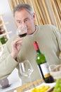 Mature man enjoying glass red wine Royalty Free Stock Photo