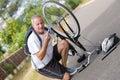 Mature man fixing bike outdoors Royalty Free Stock Photo